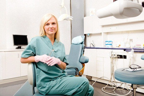 A portrait of a female dentist in a clinic